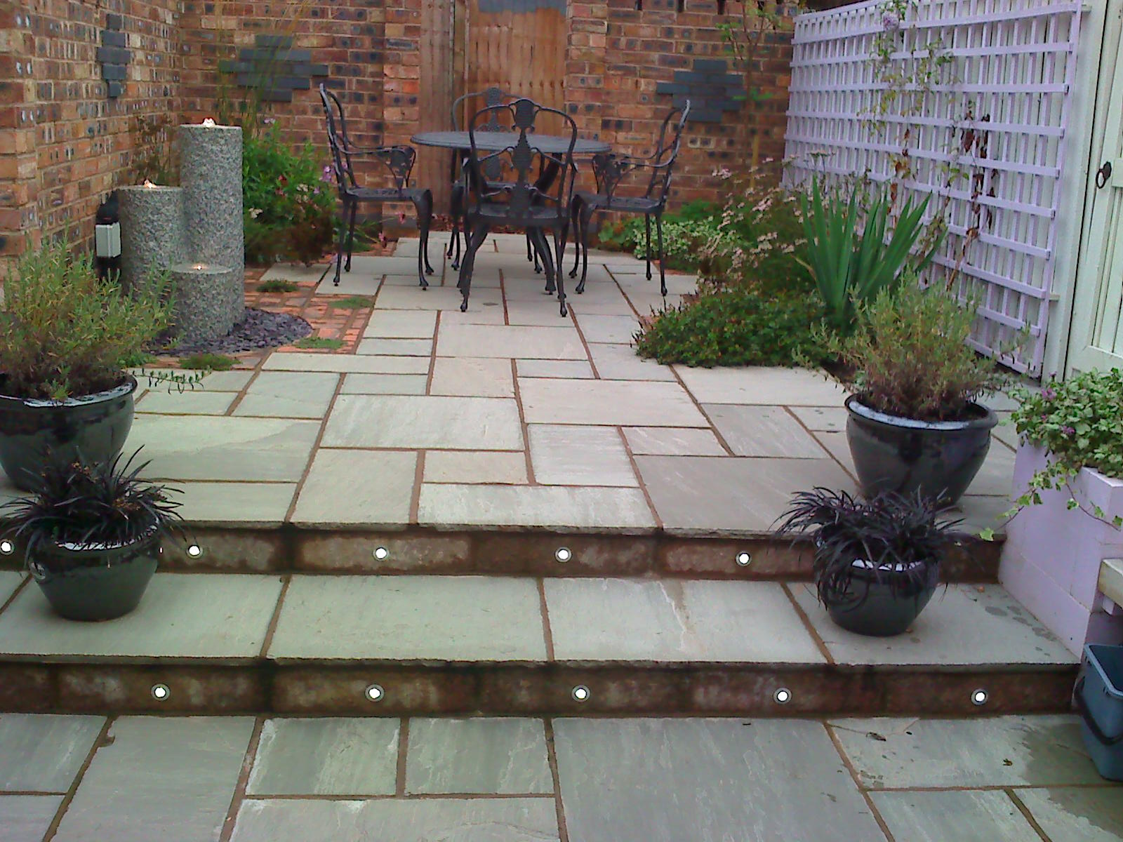 Muddy boots for Paved courtyard garden ideas
